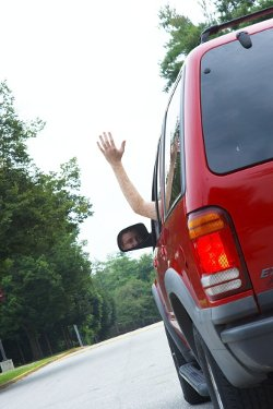 Hand waving out of car window