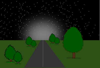 View of road at night with a glow in the distance